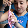 The Lunenburg Public Library had a slime making event for the kids on Wednesday morning. Evelyn Darmanin, 9,of Fitchburg plays with her newly made slime during the program at the library. SENTINEL & ENTERPRISE/JOHN LOVE