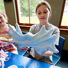 The Lunenburg Public Library had a slime making event for the kids on Wednesday morning. Persephone Katis, 11, from Lunenburg had slime all over her hands during the program at the library. SENTINEL & ENTERPRISE/JOHN LOVE