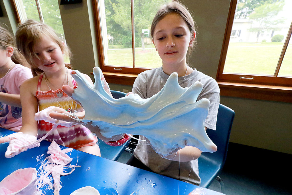 . The Lunenburg Public Library had a slime making event for the kids on Wednesday morning. Persephone Katis, 11, from Lunenburg had slime all over her hands during the program at the library. SENTINEL & ENTERPRISE/JOHN LOVE