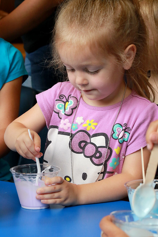. The Lunenburg Public Library had a slime making event for the kids on Wednesday morning. Jovienne Dionne, 3, of Fitchburg mixes up some food coloring in her slime mixture to give it some color. SENTINEL & ENTERPRISE/JOHN LOVE