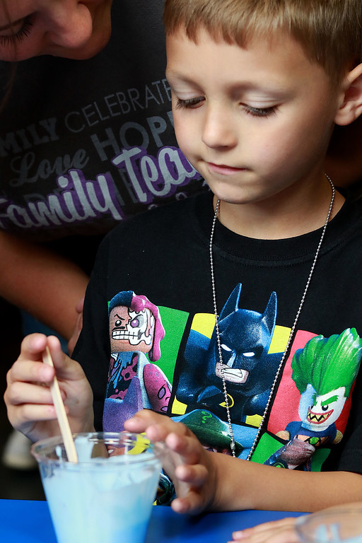 . The Lunenburg Public Library had a slime making event for the kids on Wednesday morning. Aiden Dionne, 7, of Fitchburg mixes up some food coloring in his slime mixture to give it some color. SENTINEL & ENTERPRISE/JOHN LOVE