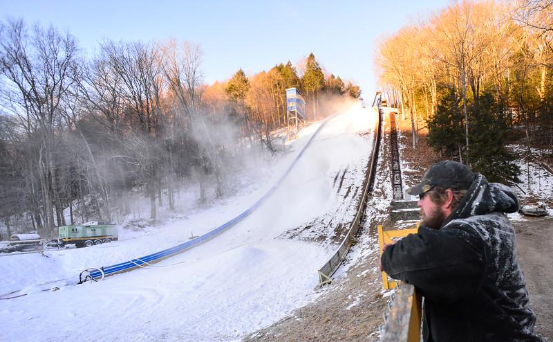 KRISTOPHER RADDER — BRATTLEBORO REFORMER<br /> Matt Butler of J Evans Construction & Vinyl Graphics checks out the snow guns at the Harris Hill Ski Jump in preparation for the 2020 competition on Thursday, Jan. 30, 2020.