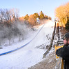 KRISTOPHER RADDER — BRATTLEBORO REFORMER<br /> Matt Butler of J Evans Construction & Vinyl Graphics checks out the snow guns at the Harris Hill Ski Jump in preparation for the 2020 competition on Thursday, Jan. 30, 2020.