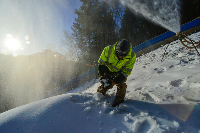 KRISTOPHER RADDER — BRATTLEBORO REFORMER<br /> Drew Christiansen of J Evans Construction & Vinyl Graphics checks out the consistency of the snow at the Harris Hill Ski Jump in preparation for the 2020 competition on Thursday, Jan. 30, 2020.