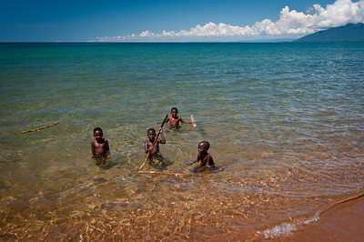 Young kids playing in Lake Malawi