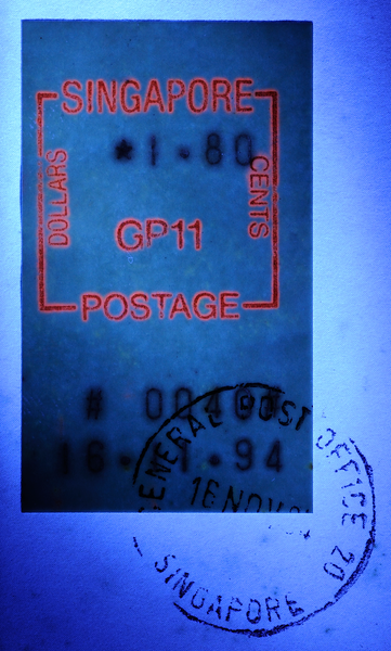 UV fluorescence of Singapore G.P.O. postage label