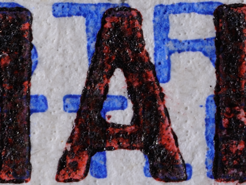 Close-up of BMA Malaya 15c 'blacking of red overprint' forgery