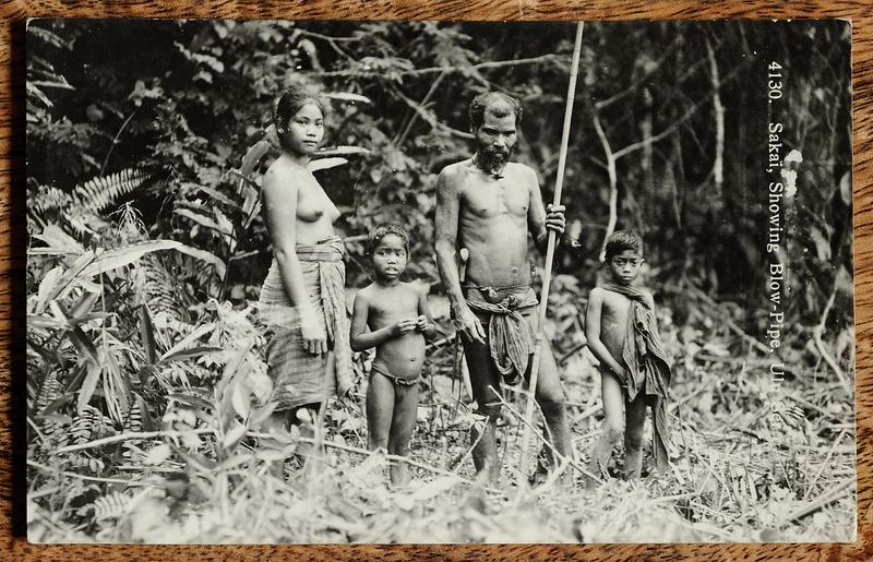 Orang Asli family in jungle on Malaya postcard