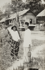 Malay couple in kampong with durian