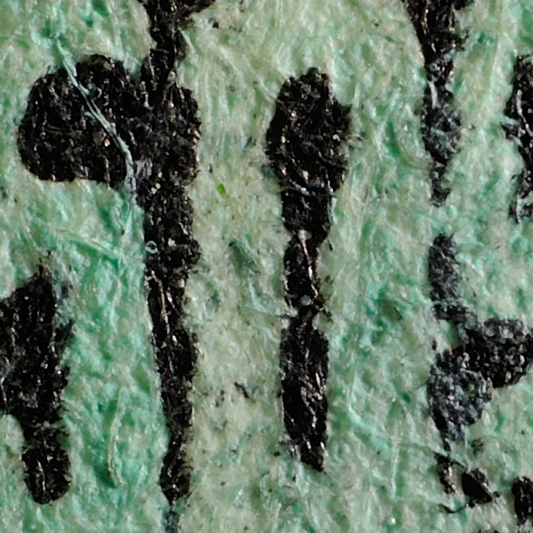 BMA Malaya 50c postal forgery: close-up of right tablet