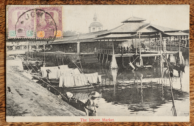 Malaya picture postcard of Johore Market on the Segget River, with Sultan Ibrahim definitive stamps