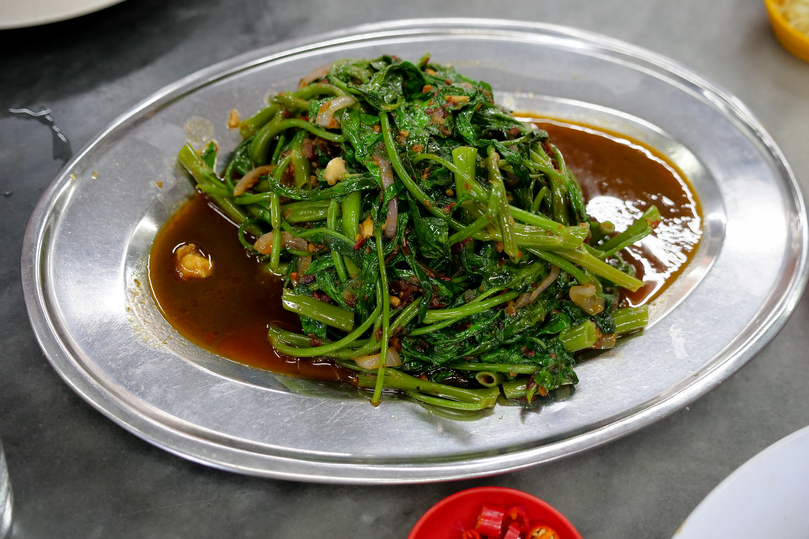 This vegetable fried with spicy sambal is mind-blowingly good, full of sour and spicy flavor, I could not get enough of this - it is a must-order dish at Mun Kee Steam Fish Head