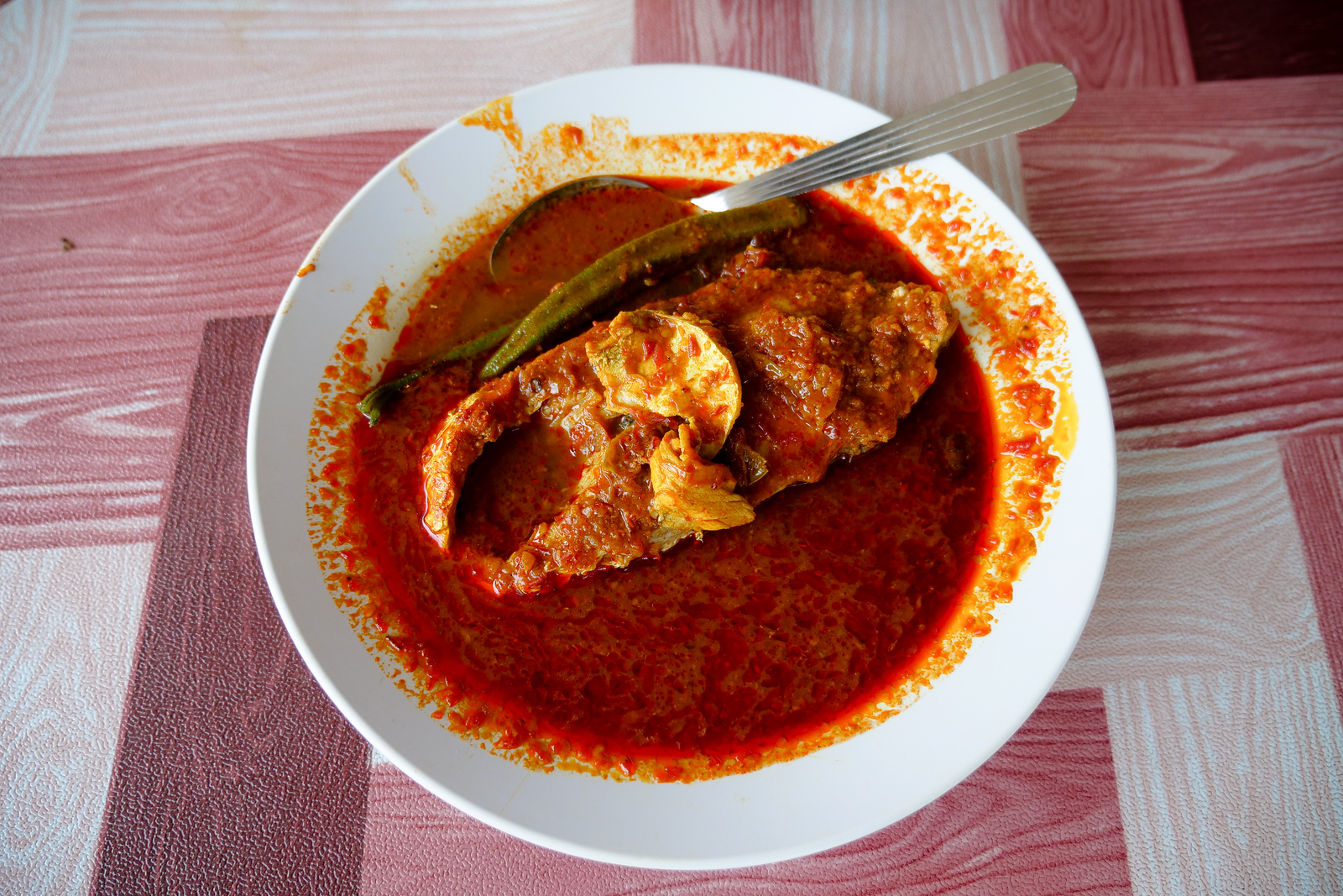 Every fish here is amazing when covered in Asam Pedas curry soup