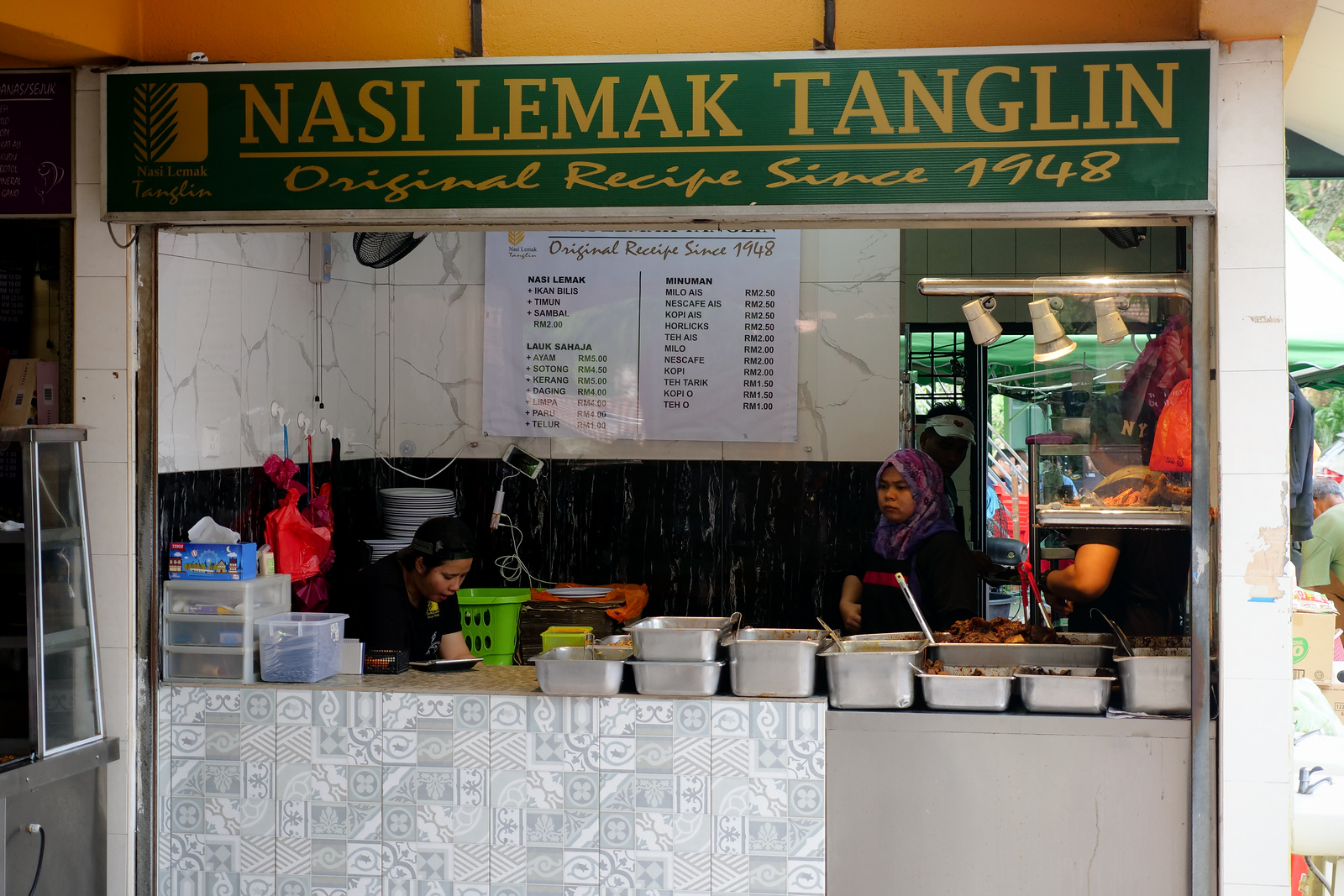 This restaurant is specializing in Malaysia's National Food, Nasi Lemak, and they also have a large selection of meats and curries to go over rice as well as the Fat Rice, Nasi Lemak, made with coconut milk and pandan leaf