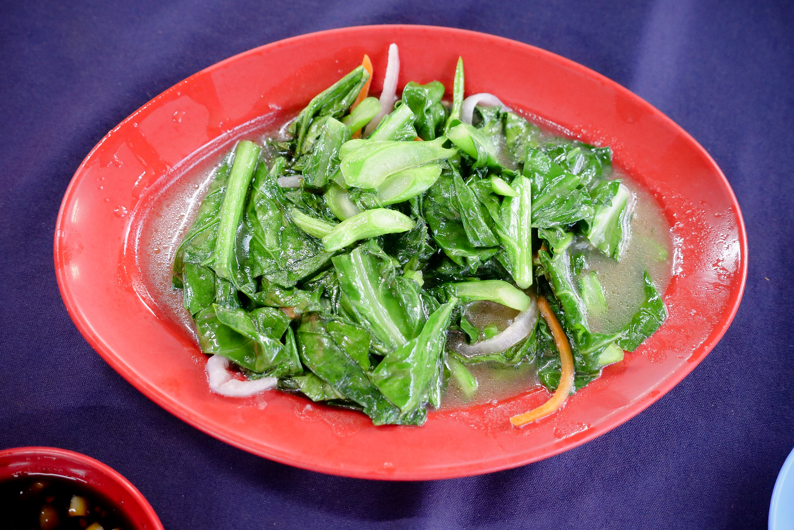 Simple vegetables go great with the salted and grilled options at Ikan Bakar Hj Musa Restaurant
