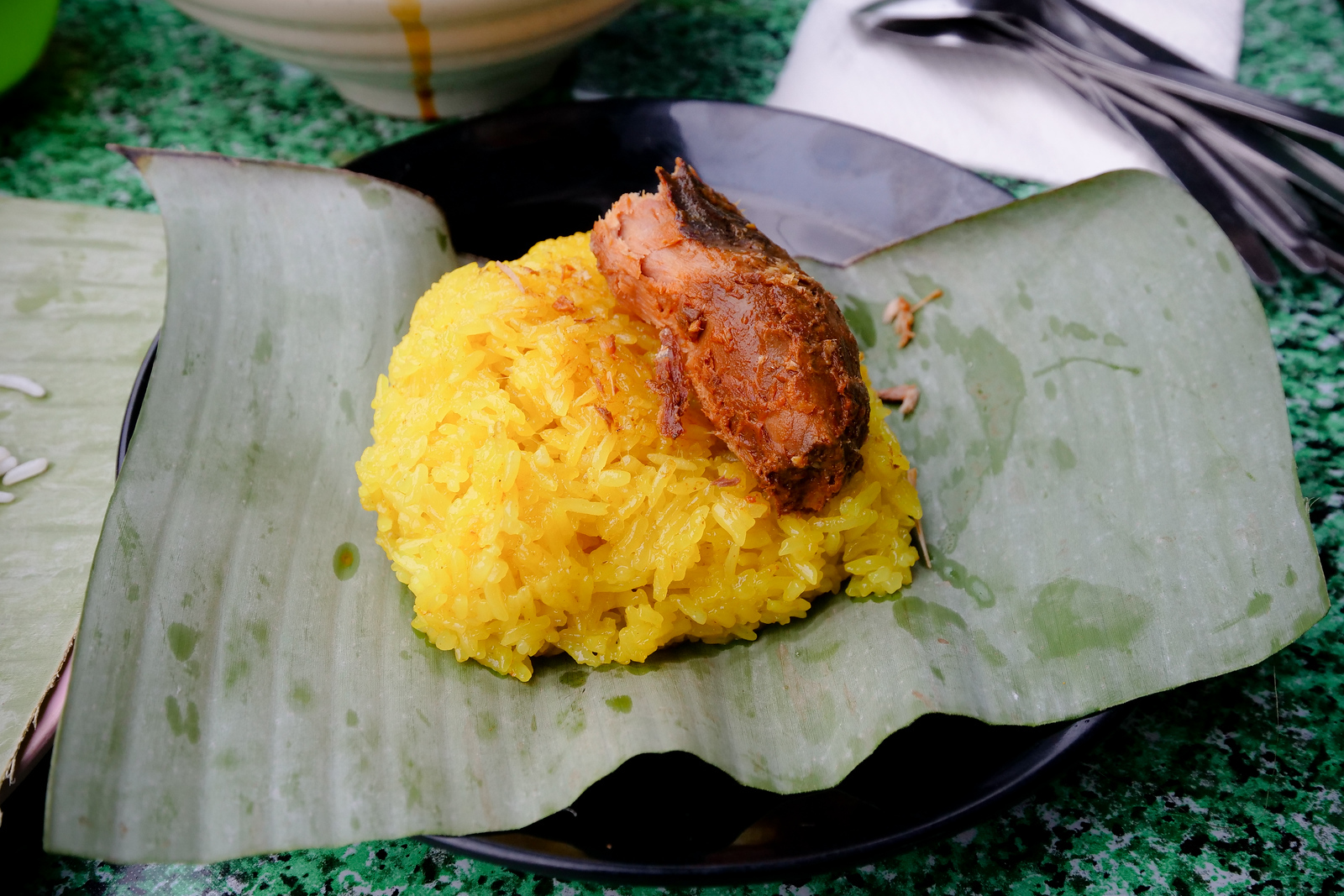 Nasi kunyit is turmeric flavored (and colored) sticky rice