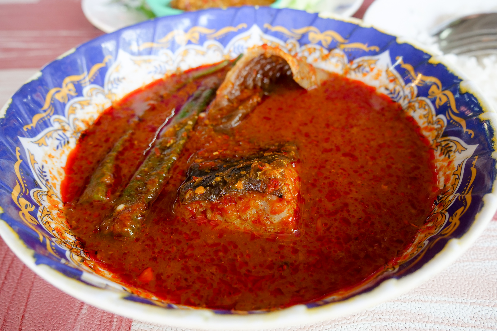Stingray cooking in sour spicy Asam Pedas curry soup