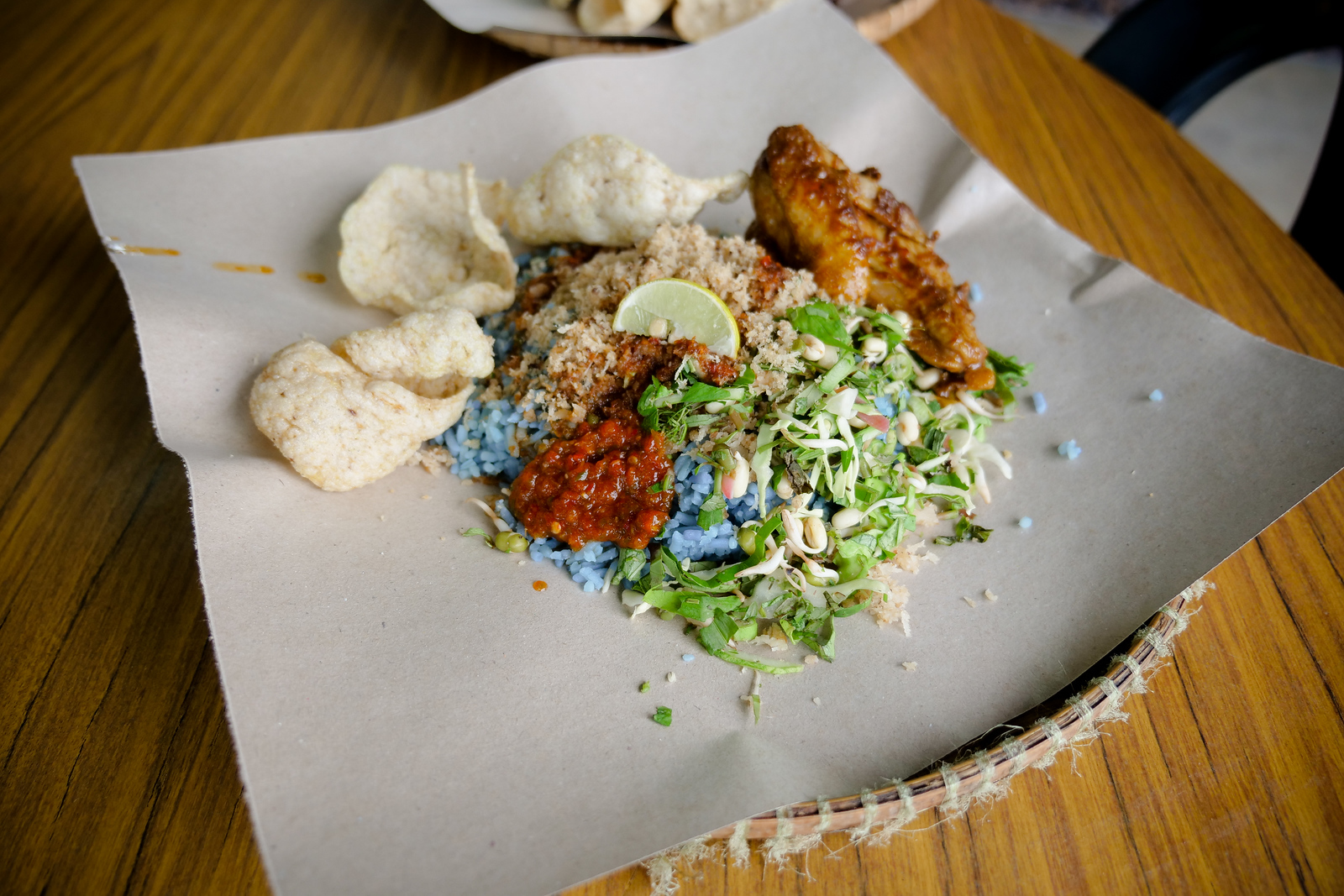 Colorful ingredients and deliciously smoky meat aromas make Nasi Kerabu one of the must-try dishes on any trip to Kelantan, Malaysia