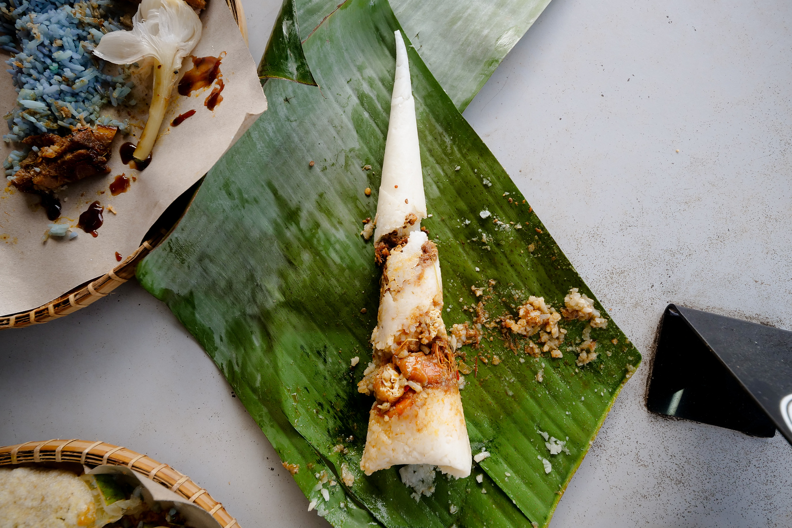Cone shaped rolled snacks of shrimp and rice are also sold in front of the rice counter at Nasi Kerabu Panji