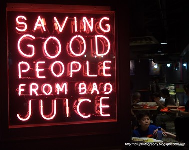 A neon sign in a food court in Kuala Lumpur, Malaysia in August 2017. Saving good people from bad juice