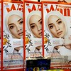 Magazine for sale in Malacca, Malaysia in August 2017. Mingguan Wanita with a pretty woman in a hijab on the cover