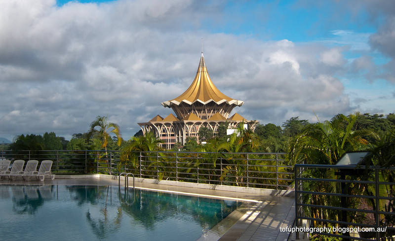 The Sarawak State Assembly Building seen from the swimming pool at the Riverside Majestic Hotel in Kuching, Malaysia in January 2012
