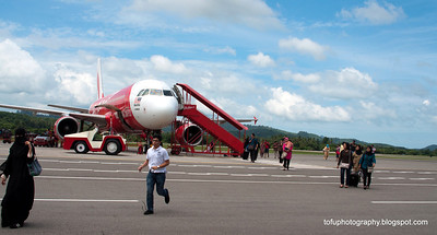 An Air Asia jet at Langkawi airport, Malaysia in June 2011