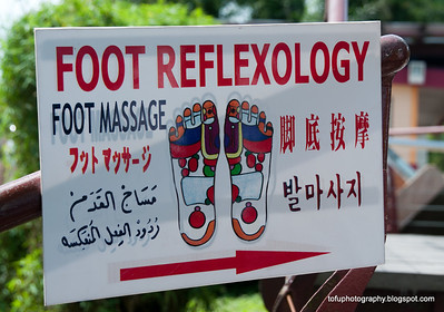 A foot reflexology sign in several languages at Langkawi, Malaysia, in June 2011