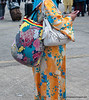 Brightly garbed woman with a very colourful bag at Langkawi airport, Malaysia in June 2011