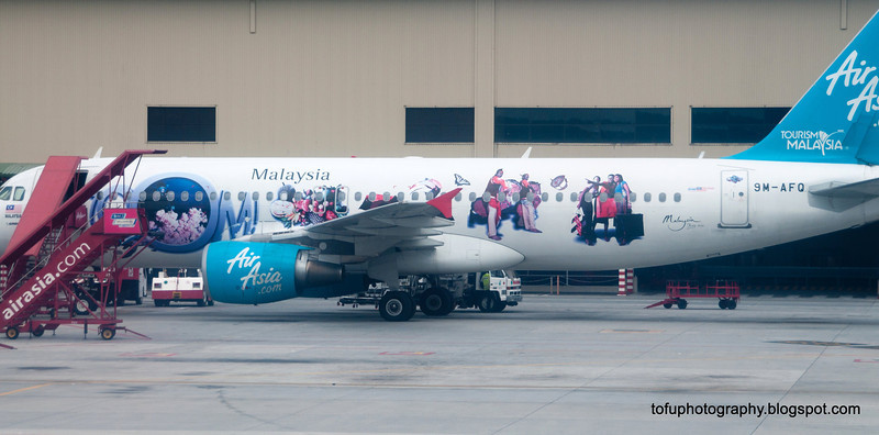 A colourful Air Asia jet on the tarmac at Kuala Lumpur, Malaysia in June 2011