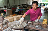 Young people working at the pewter manufacturing shop in Johor Bahru, Malaysia.