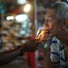 "<a href=""http://nomadicsamuel.com/photo-blog/man-smoking-petaling-street-kuala-lumpur-malaysia-travel-photo"">http://nomadicsamuel.com/photo-blog/man-smoking-petaling-street-kuala-lumpur-malaysia-travel-photo</a> : Today's daily travel photo is of a man smoking as pedestrians pass by him on busy Petaling Street market at night - Kuala Lumpur, Malaysia."