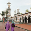 In matching tudungs at the Jamek Mosque