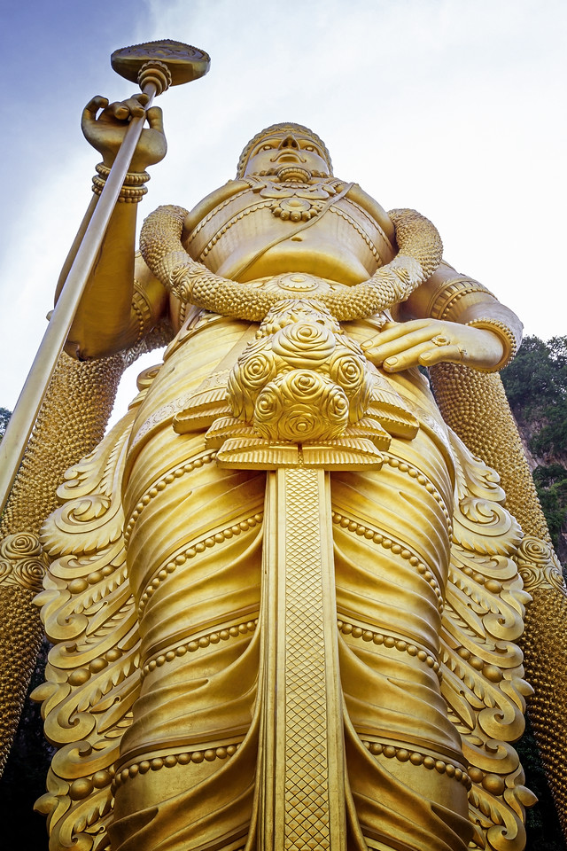 The massive golden statue of the Hindu God Muruga at Batu Caves