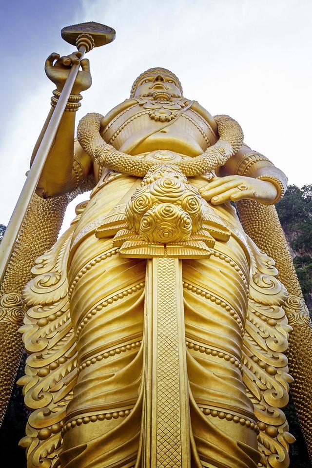 The massive golden statue of the Hindu God Muruga at Batu Caves