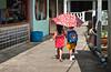 Children walking to school in Kukup Village, Malaysia.