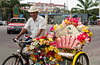 A street peddler with tricycle selling flowers in Chinatown, Melacca, Malaysia.