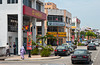 A modern street with stores and shops in Malacca, Malaysia.