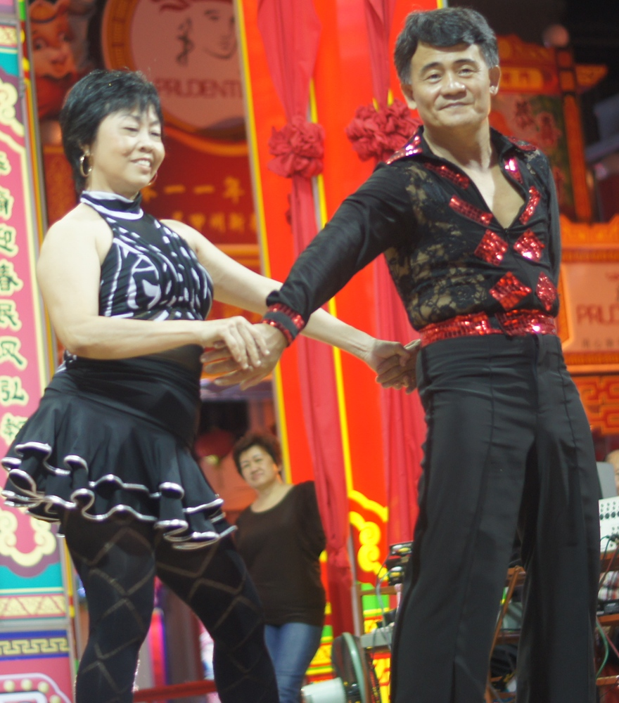 A talented couple perform their dance moves on the largest stage at the end of the Jonker Street Night Market