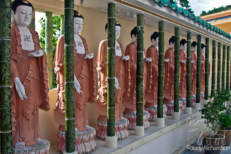 Line of Buddhas on an outdoor terrace in Kek Lok Si Temple.