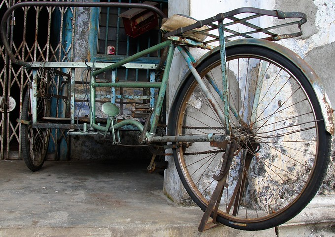 A parked rickshaw on the streets of George Town (Penang), Malaysia.