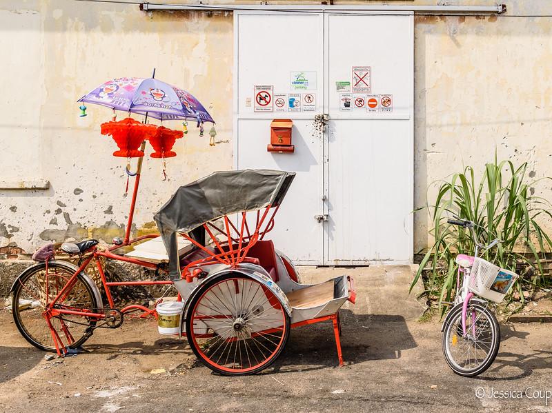 Red Trishaw and Pink Bike