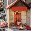Shrine Next to the Garbage