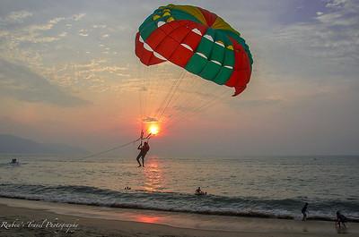 Sun setting on Batu Ferringghi beach