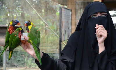 Woman from Kuwait visiting the Bird Park in Kuala Lumpur, Malaysia.