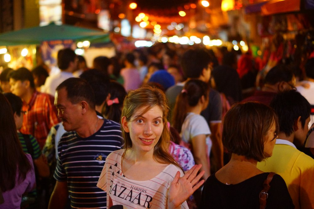 The lovely Audrey Bergner of That Backpacker poses for a crowd perspective night shot during the busiest of times.