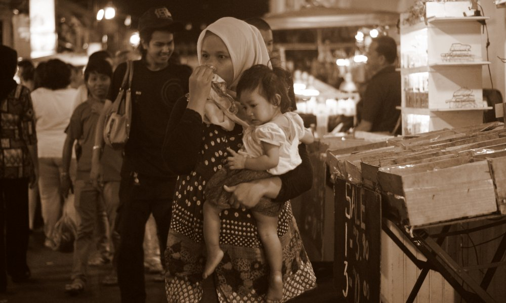 Mother and daughter make their way down the ever hectic Jonker Street night market.