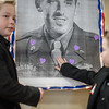 Zyler Zufelt, 11 (left) and Zayden Zufelt, 9 (right) of Townsend, 2 of 27 great grand children, place purple heart stickers onto a portrait of great grandfather and Leominster native Malcolm Brown who celebrates his 100th birthday at the Veterans Memorial Center in Leominster on Sunday April 9, 2017.  Malcolm Brown is a Purple Heart recipient for his service in the Battle of the Bulge where he took shrapnel to the face which remains embedded in his cheek till this day.(Sentinel & Enterprise photo/Jeff Porter)