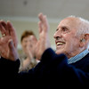 100 year old Malcolm Brown waves to the crowd after a chant set off by Malcolm's son Dave at his 100th birthday celebration held at the Veterans Memorial Center in Leominster on Sunday April 9, 2017.  (Sentinel & Enterprise photo/Jeff Porter)