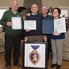 Left to right; Son Dave Brown, father Malcolm Brown, son George Brown and daughter Lisa Achille pose for a portrait with certificates of honor from the mayors office, Leominster Veterans Council and the state senate along with a Purple Heart postage stamp for Malcolm's 100th birthday party held at the Veterans Memorial Center in Leominster on Sunday April 9, 2017.  (Sentinel & Enterprise photo/Jeff Porter)